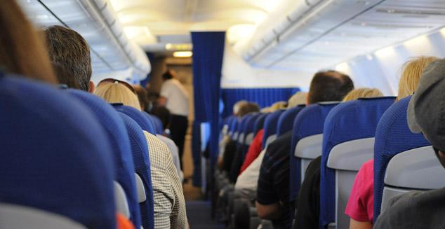 Airplane travelers sitting in cabin