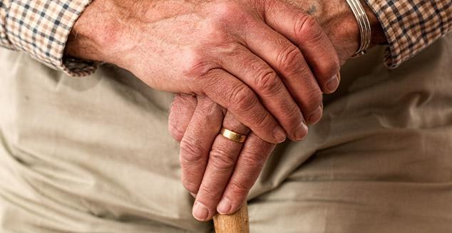 Elderly man hands with cane