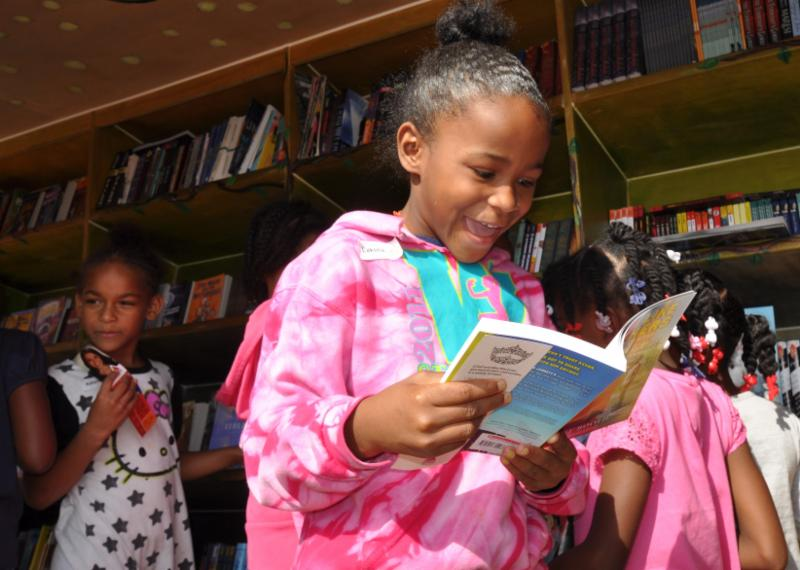 Girl excited about book