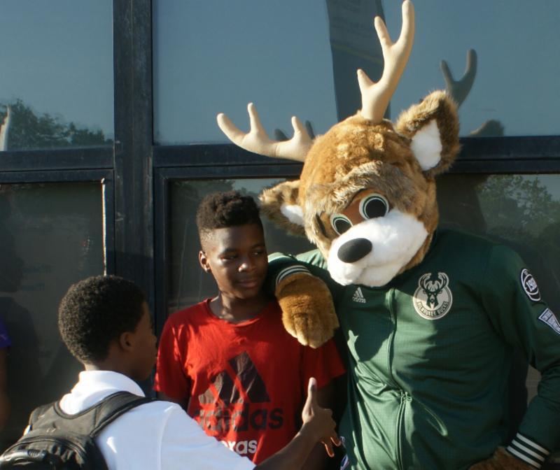 Bucks mascot with boys