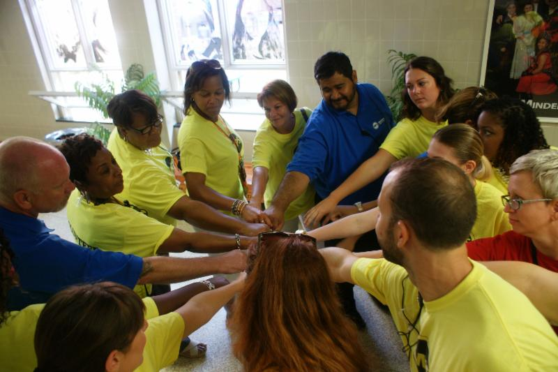 Staff circle with hands in