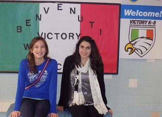 Girls at welcome sign
