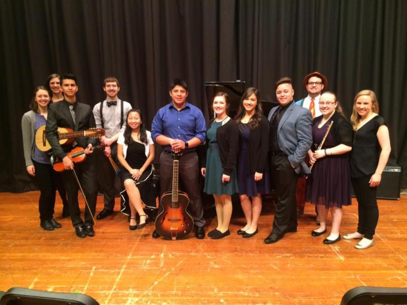 High school instrumental students with teacher