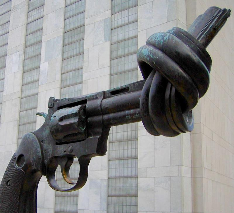 A statue of a revolver with the barrel twisted
