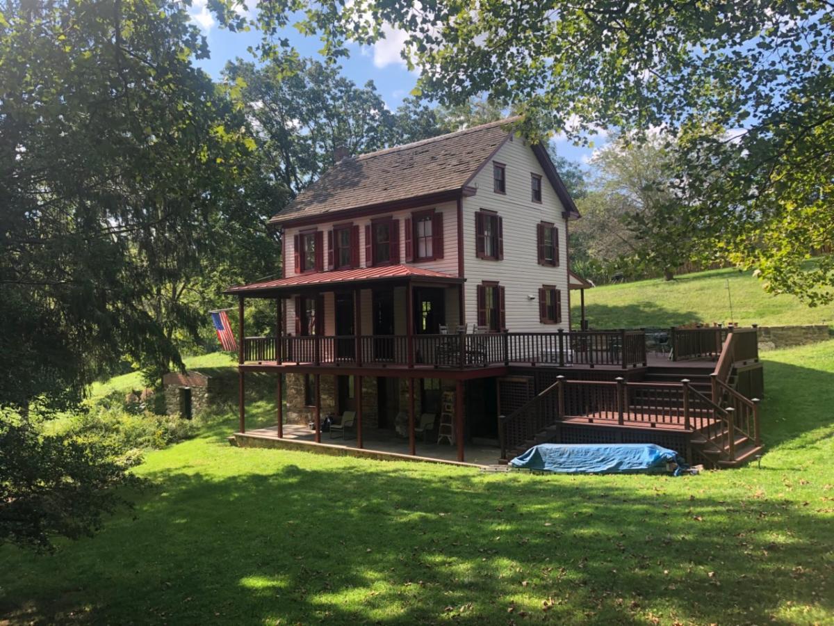 A farmhouse with a deck