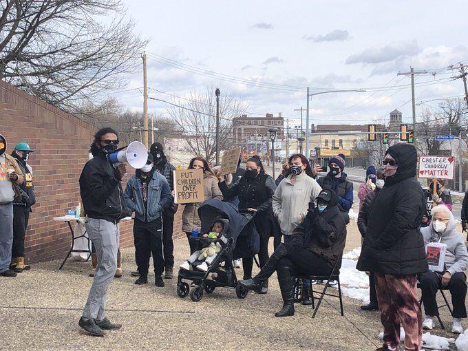 Chester parents and teachers hold a rally protesting a rushed outsourcing process