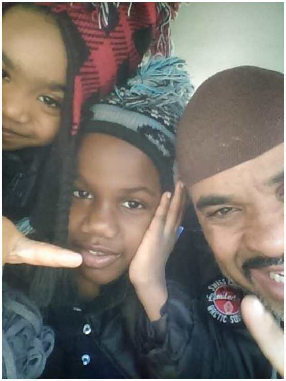 Federal Detention Center client Allen Woods and his children
