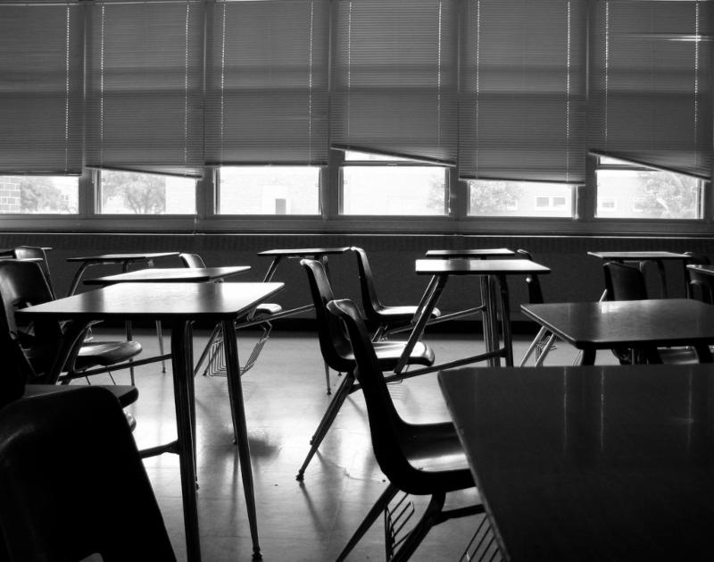An empty classroom in black and white