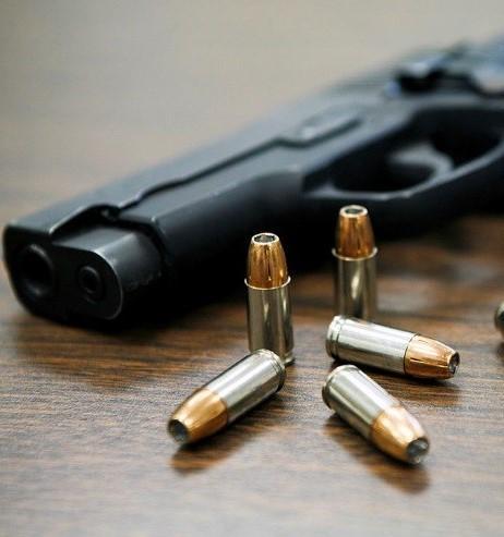 A handgun with bullets