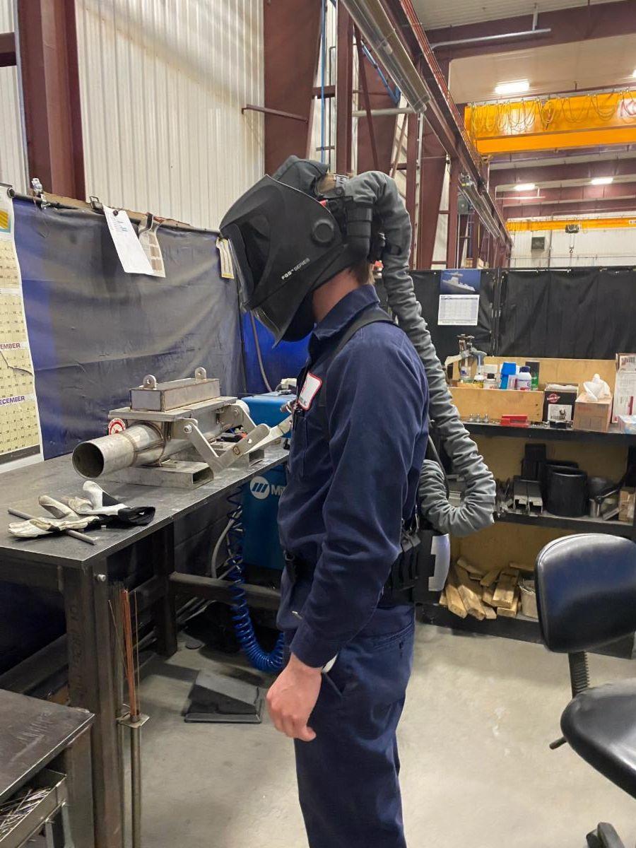 IMI welder wearing PPE