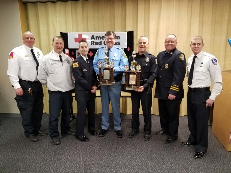Battle of the Badges participants with award