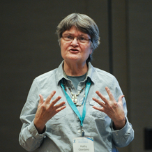 Photo showing Kathy Giordano speaking and gesturing