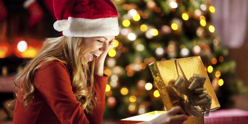 woman opening gold holiday gift
