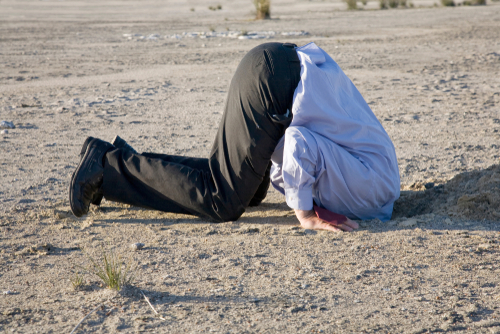 A powerful denial concept_ man with his head in the sand.