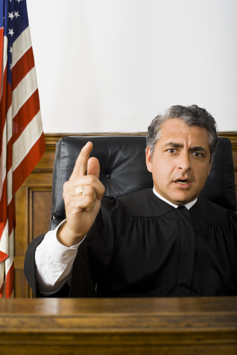 Portrait of a male judge pointing