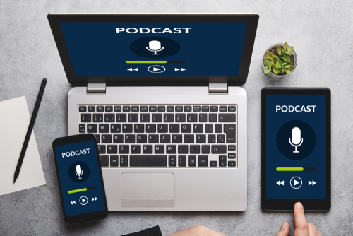Podcast concept on laptop_ tablet and smartphone screen over gray table. All screen content is designed by me. Flat lay