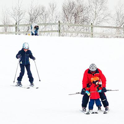 A family downhill skiing.