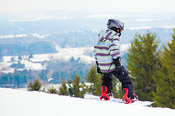 A young child snowboarding.