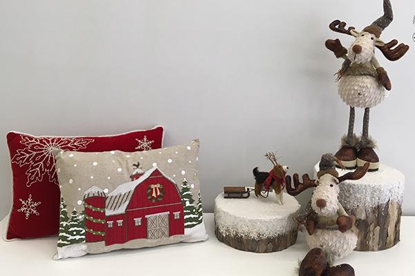 Christmas pillows and decorations for sale.