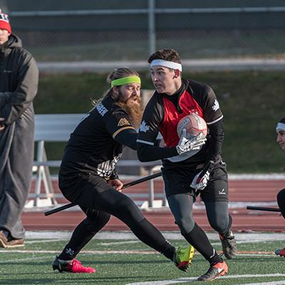 Two players vie for the ball during a match of Quidditch.