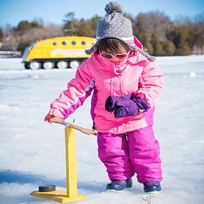 Young girl ice fishing