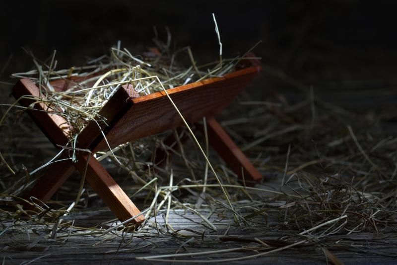 Manger in the stable in night closeup