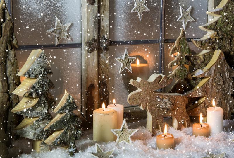 Natural christmas window decoration with handmade reindeer and trees of wood.     Note  Shallow depth of field