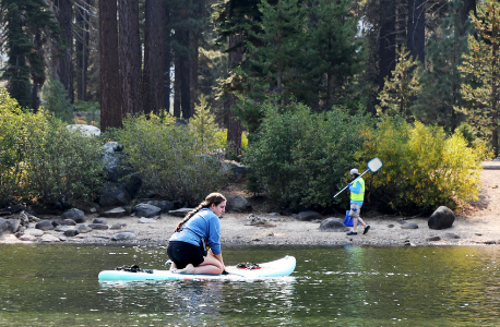 Staff and volunteers survey Donner Lake.
