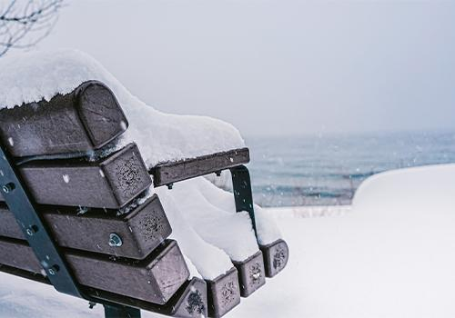 January snow on a bench in Tahoe