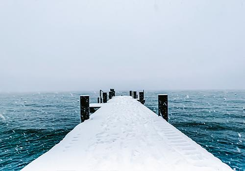 January snow on a dock  in Tahoe