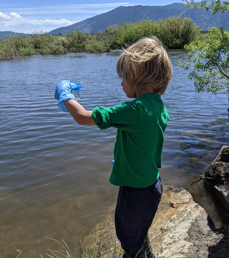 A young citizen scientist samples water quality