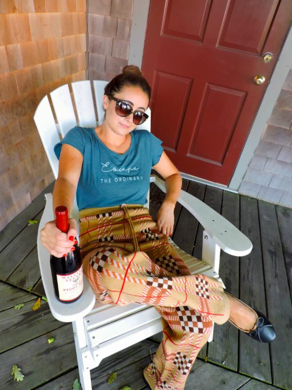 "Burberry knit pant,  Size S, $236;  ""Escape the Ordinary"" Tee, Sizes XS-M, $45.  Contrast trim Ballet flat, Size 8, $58.  Williams-Selyem ""Westside Road Neighbors"" RRV Pinot Noir 2012, $115."