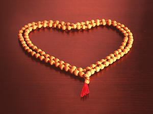 Prayer bead in the shape of a heart