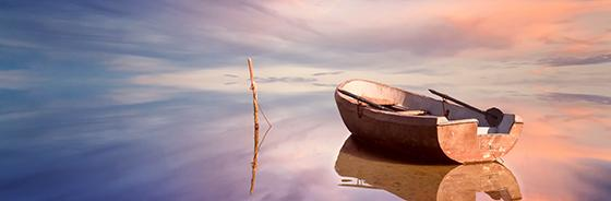 Empty boat on reflective water