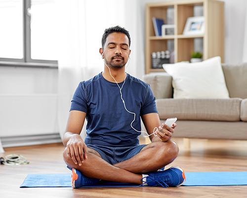 Man meditating at home