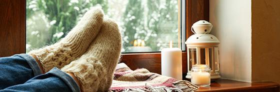 stocking feet on window sill