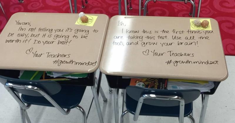 two student desks with a note on them to helpd the students to build a growth mindset for taking the standardized test