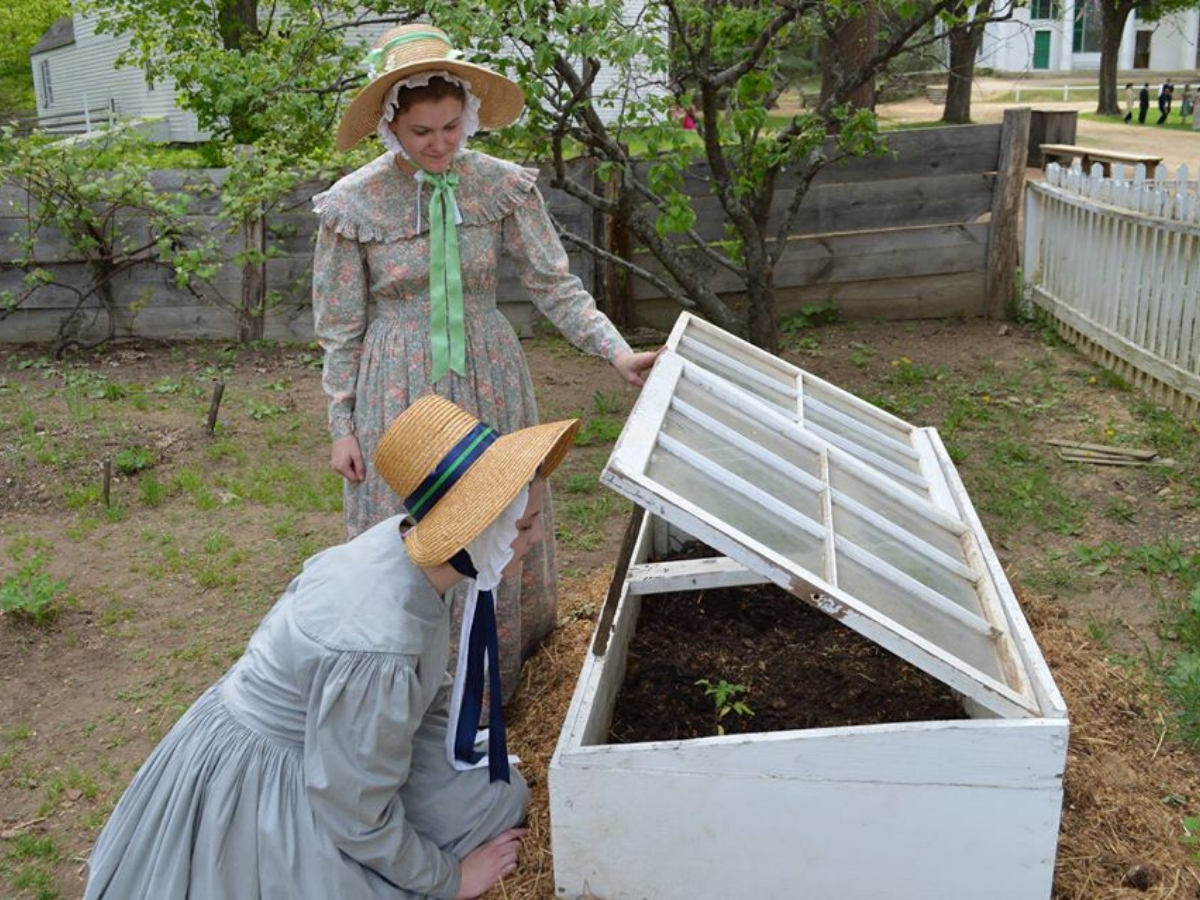 Two interpreters look into a hot frame in the Parsonage Garden