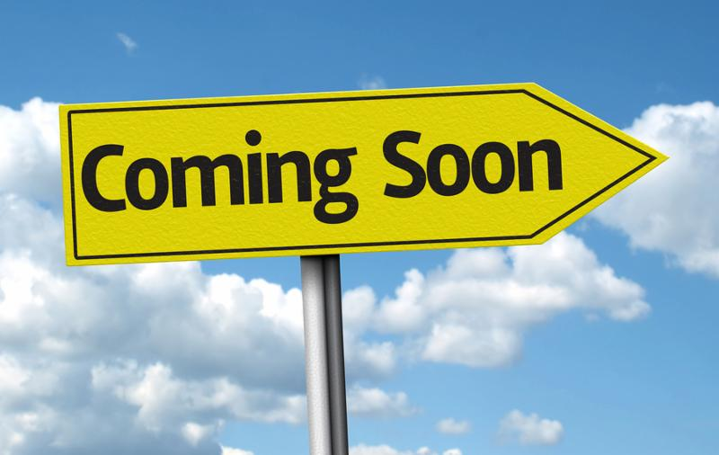 Coming Soon creative sign on a beautiful day