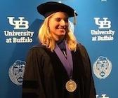Photo of Dr. Nickerson_ in commencement regalia_ wearing medal