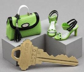 Purse and sandals beside a door key