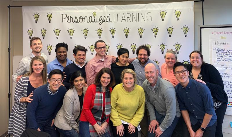 Innovation Directors Network group stands in front of Personalized Learning backdrop.
