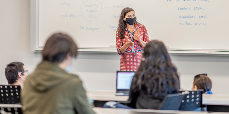 Teacher in front of class wearing mask