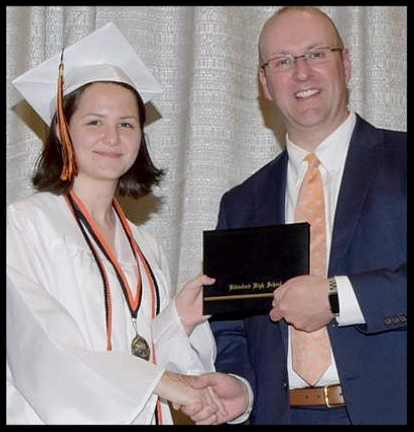 Caroline Gallant accepting her diploma