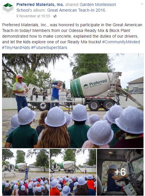 Readymix truck surrounded by children in hardhats