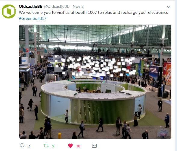 Circular trade show exhibit with lights hanging above it