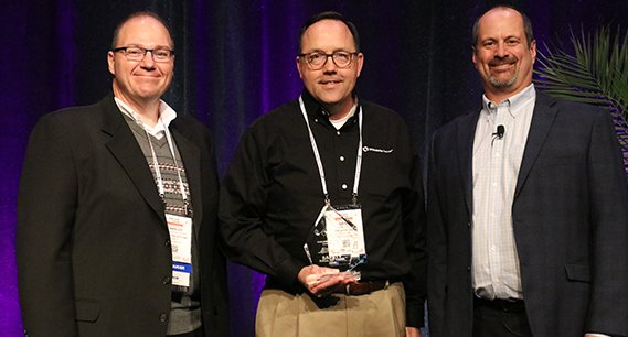 Three individuals from Oldcastle Precast Receiving Award