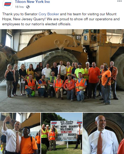Employees in front of heavy equipment