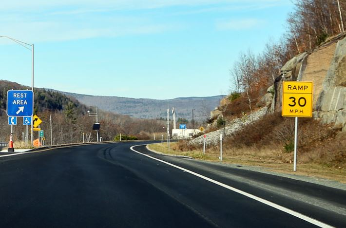 paved road with mountains in the distance