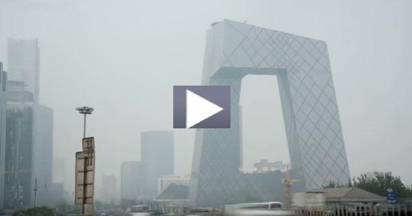 Screenshot of video screen showing a modern building